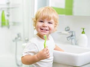 toddler boy brushing teeth